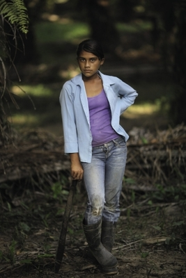 Elsia Acosta, 13, clearing reclaimed land.AP Photo / Rodrigo Abd