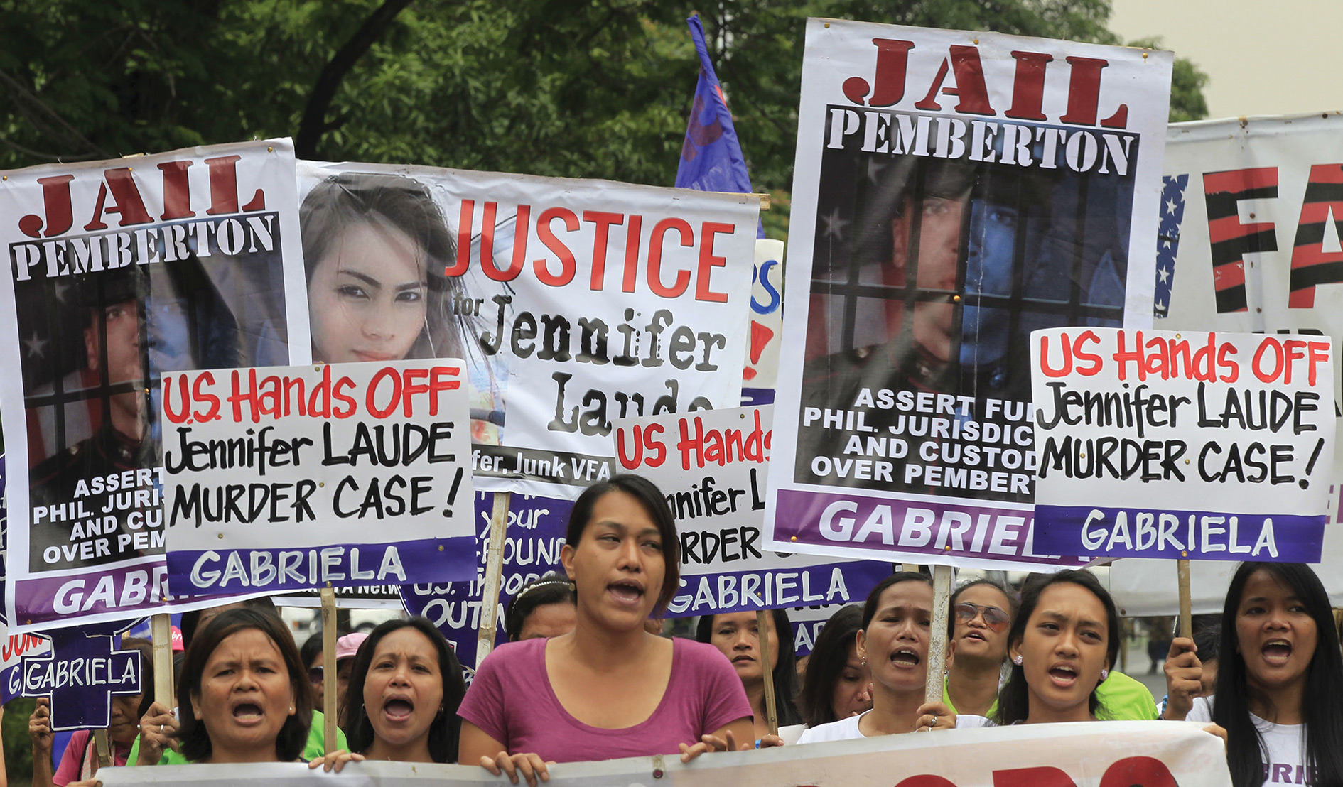 Activists in Manila protest against the murder of Filipina trans  woman  Jennifer Laude. US marine Joseph Scott Pemberton, who strangled her, claimed 'trans panic' in his defence.