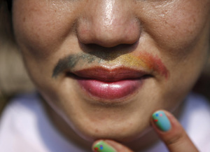 Expressing a gender spectrum on their face – a trans person takes part in the 2015 Korea Queer Festival, held in Seoul.Kim Hong-Ji/Reuters