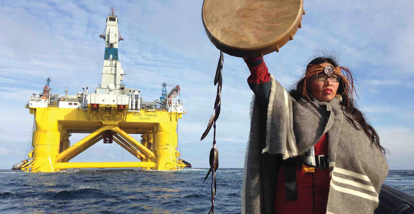 You Shell not pass: First Nations activist and singer Audrey Siegl confronts the oil giant's drilling rig on its way to the Arctic. Photo: Emily Hunter / Greenpeace