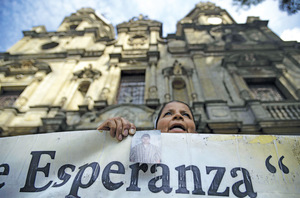Cause for hope? The end to Colombia's 50-year civil war may hasten an end to forced disappearances like those denounced above by a woman in Medellín in September.Photo: Raul Arboleda/AFP/Getty Images
