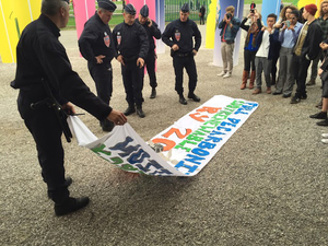 Police with banner.