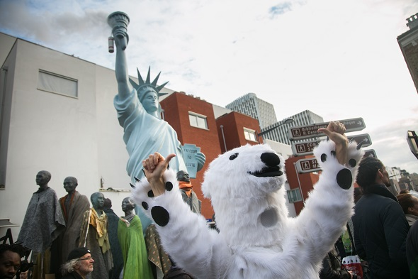 Danish MP Christian Poll temping for artist Jens Galshiøt as a polar bear. Citizen Climate Summit in Montreuil. A host of organizations, small NGOs, political art events and food stalls set the scene for discussions and debates on climate change as an alternative to the official COP21 in Bourget. The official climate talks in Paris is on and the pressure to come up with a sustainable legally binding is high. In the aftermath of recent terrorist attacks public demonstrations have been banned during the two weeks of climate talks.