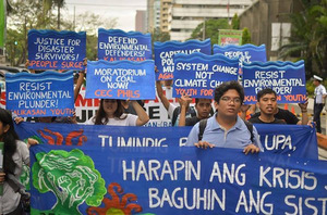 Filipino climate and environmental activists helped mobilize thousands during the global people's climate march during the weekend before the opening of COP21.Photo by Loi Manalansan/Kalikasan