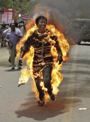Last resort: Tibetan exile Jampa Yeshi sets himself on fire in protest at a visit to New Delhi of Chinese president Hu Jintao in March.
