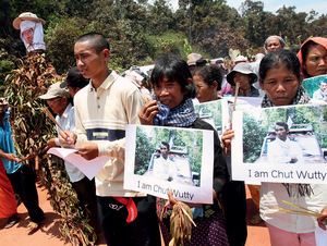 Slain Cambodian activist Chut Wutty's son marches with supporters following his father's murder in 2012. Wutty was killed while investigating illegal logging in southwest Cambodia.  <br />