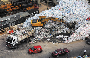Moving mountains: in March, trucks began clearing nine months' worth of accumulated rubbish.