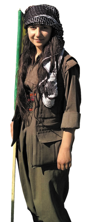 A young woman in a guerrilla outfit at the Turkish border. The Kurdish community was outraged when H&M tried to appropriate this style of dress.
