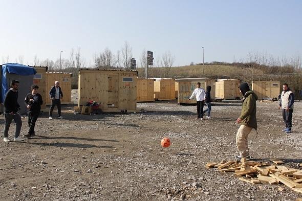 Residents kick a football around.