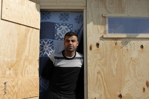 Simon, a Kurd from Iraq, in his new shelter.Photo by Sarah Shearman
