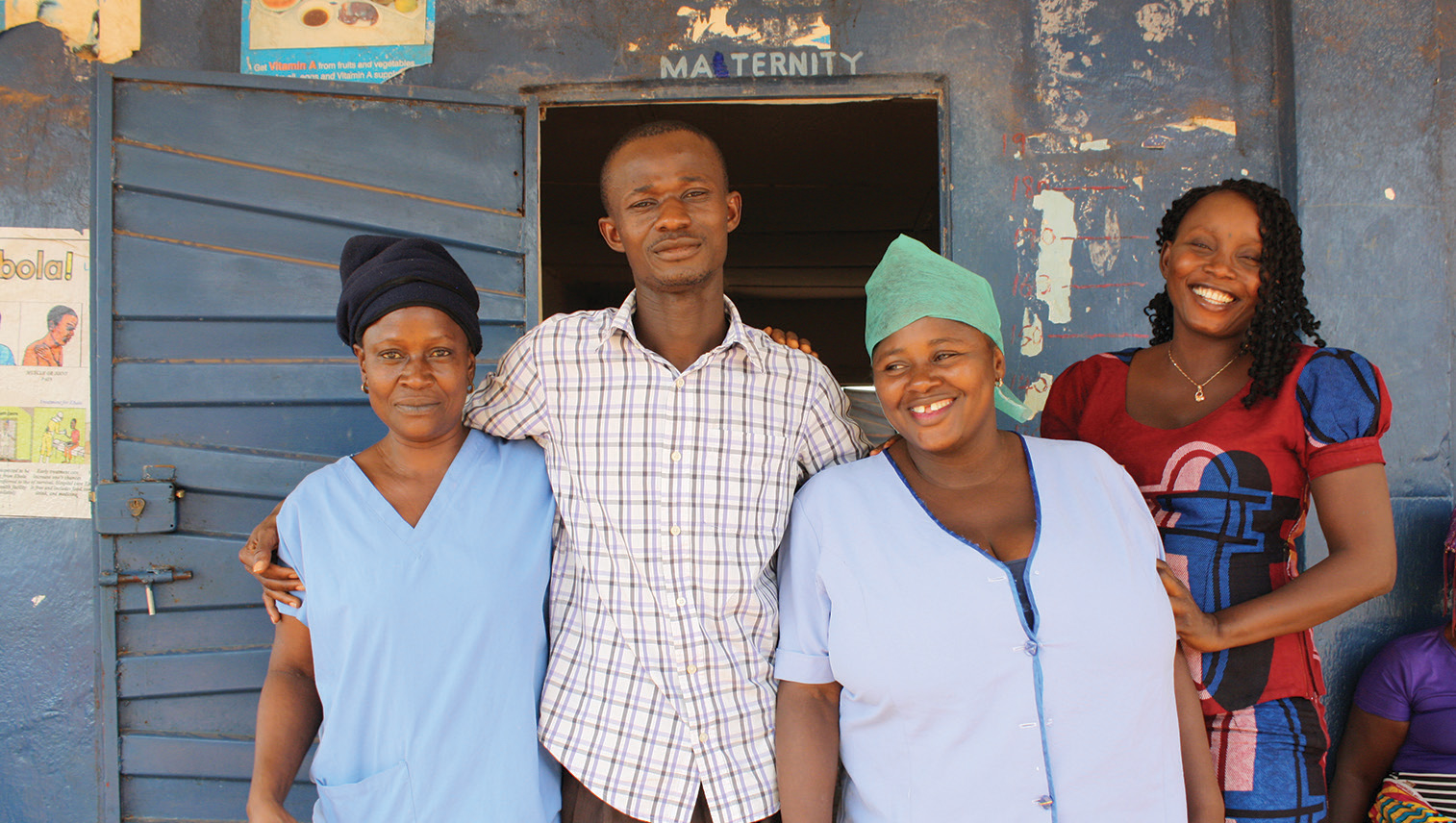 On high alert, post-Ebola: Nafisatu Jabbi (centre right) at the Koindu community clinic, accompanied by a newly replenished staff team, including Community Health Officer Alfonsus Vandi (centre left).