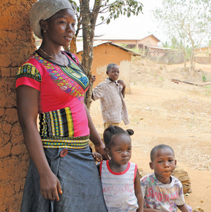 Serah Tomba with Satta and Paul,  two of the orphans she is raising since Ebola. A neighbour's child looks on. Photo: Hazel Healy