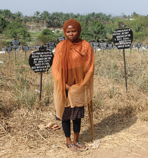 'People were just buried with sticks for markers': Mariama Jalloh despairs of finding her father's grave on arrival at the overgrown burial site for Ebola victims in the southern city of Bo.