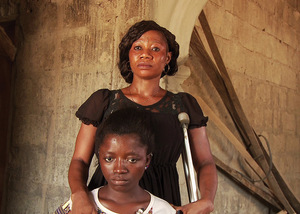 'Obstetric fistula stops with me.' Elizabeth Katta stands with Satta, a girl from her self-help group. Four of its members fell pregnant during Ebola.