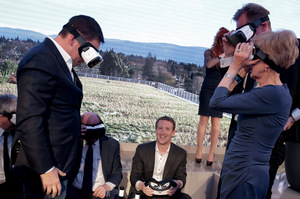Facebook founder Mark Zuckerberg  (centre) and friends play with virtual reality gear at a high-level gathering earlier this year.Photo: Kay Nietfield/Reuters