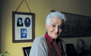 Hilda Farfante was five years old when Franco's henchmen killed her parents, whose pictures hang on the wall behind her.