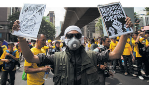 Anti-corruption protesters in Kuala Lumpur. Embezzlement and deceit are rife among Malaysia's ruling elite.