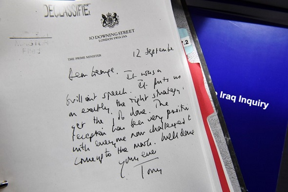 Detail of a declassified handwritten letter sent by the then British Prime Minister Tony Blair, to George W. Bush, former President of the United States, is seen as part of the Iraq Inquiry Report presented by Sir John Chilcot at the Queen Elizabeth II Centre in Westminster, in London, Britain 6 July 2016.