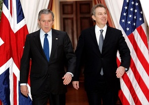 US President George W. Bush (L) and British Prime Minister Tony Blair walk together from their meeting at the U.S. Embassy in Brussels, 22 February 2005.
