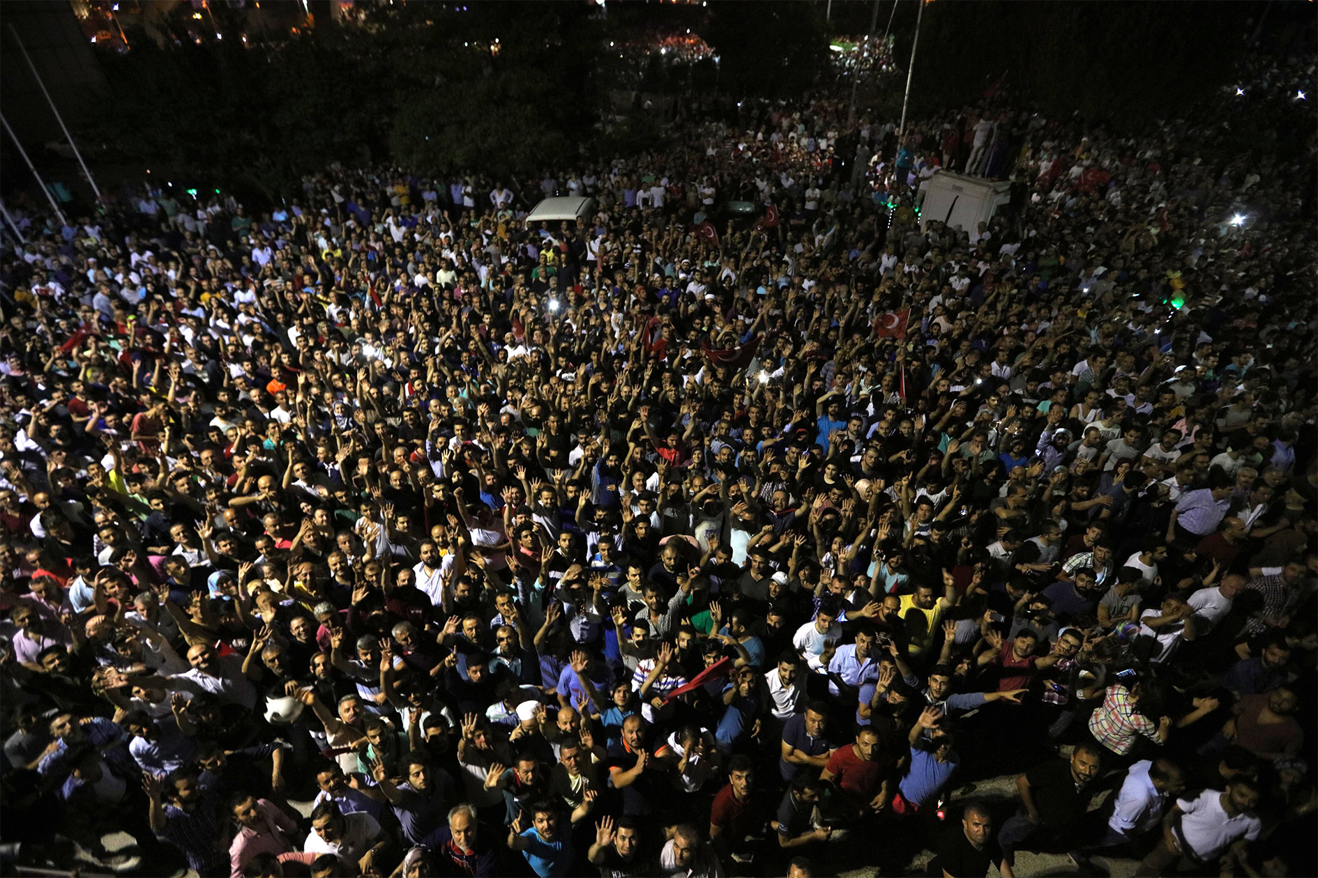 People demonstrate outside Ataturk international airport during an attempted coup in Istanbul, Turkey.