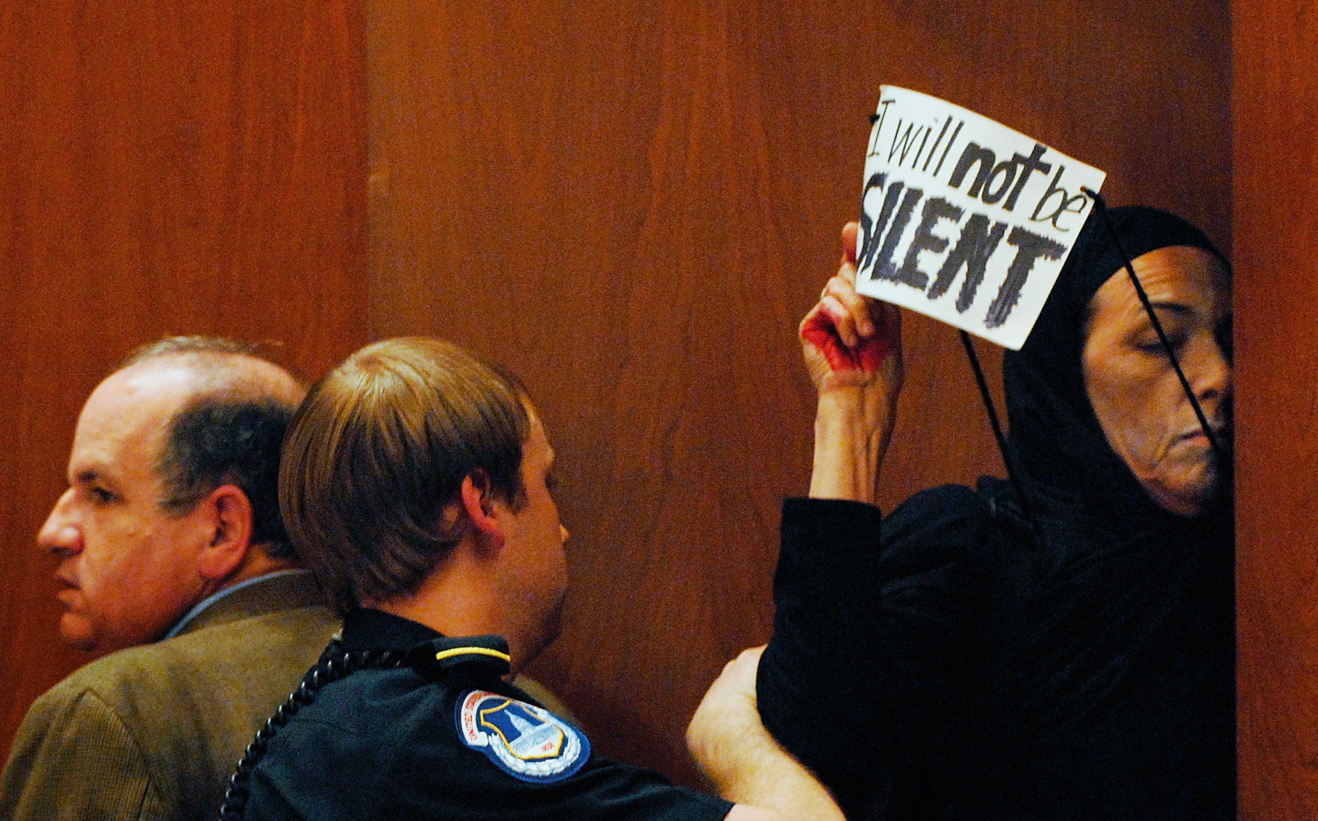 Speaking truth to power: a protester makes her point before being bundled out of a US Senate hearing on the Iraq war.