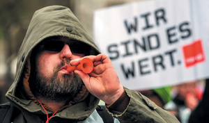 'We're worth it!' Members of the German ver.di trade union make a noise ahead of wage negotiations in April.