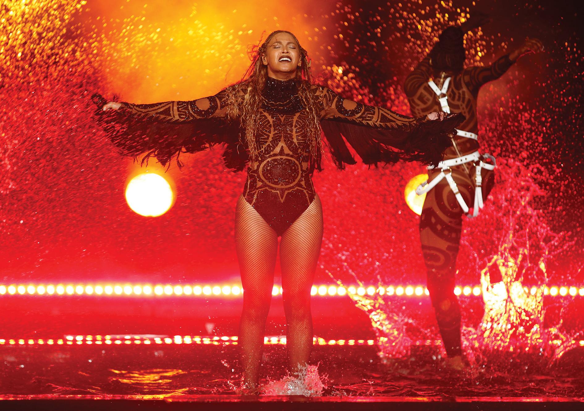 Unlikely godmother: Beyoncé, seen here performing 'Freedom' in California, has helped some African writers to reach a wider audience.