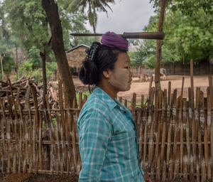 Thwe Thwe Win walks to her farm near the copper mine in Burma.