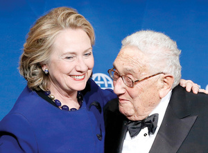 Bosom buddies: Hillary Clinton's cosy relationship with Henry Kissinger is nothing to laugh about.
