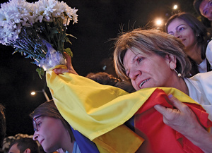 Colombians cling to the glimpse of peace offered by the historic accord between FARC and the government.Photo: Guillermo Lagaria/AFP/Getty