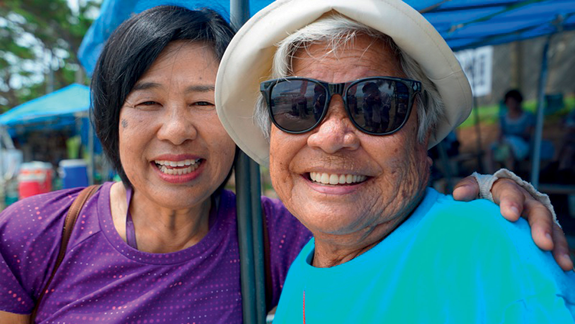 Fumiko Shimabukuro (right), an Okinawa World War Two survivor, is now fighting to save a bay from US bombers. With her is Eiko Ginoza.