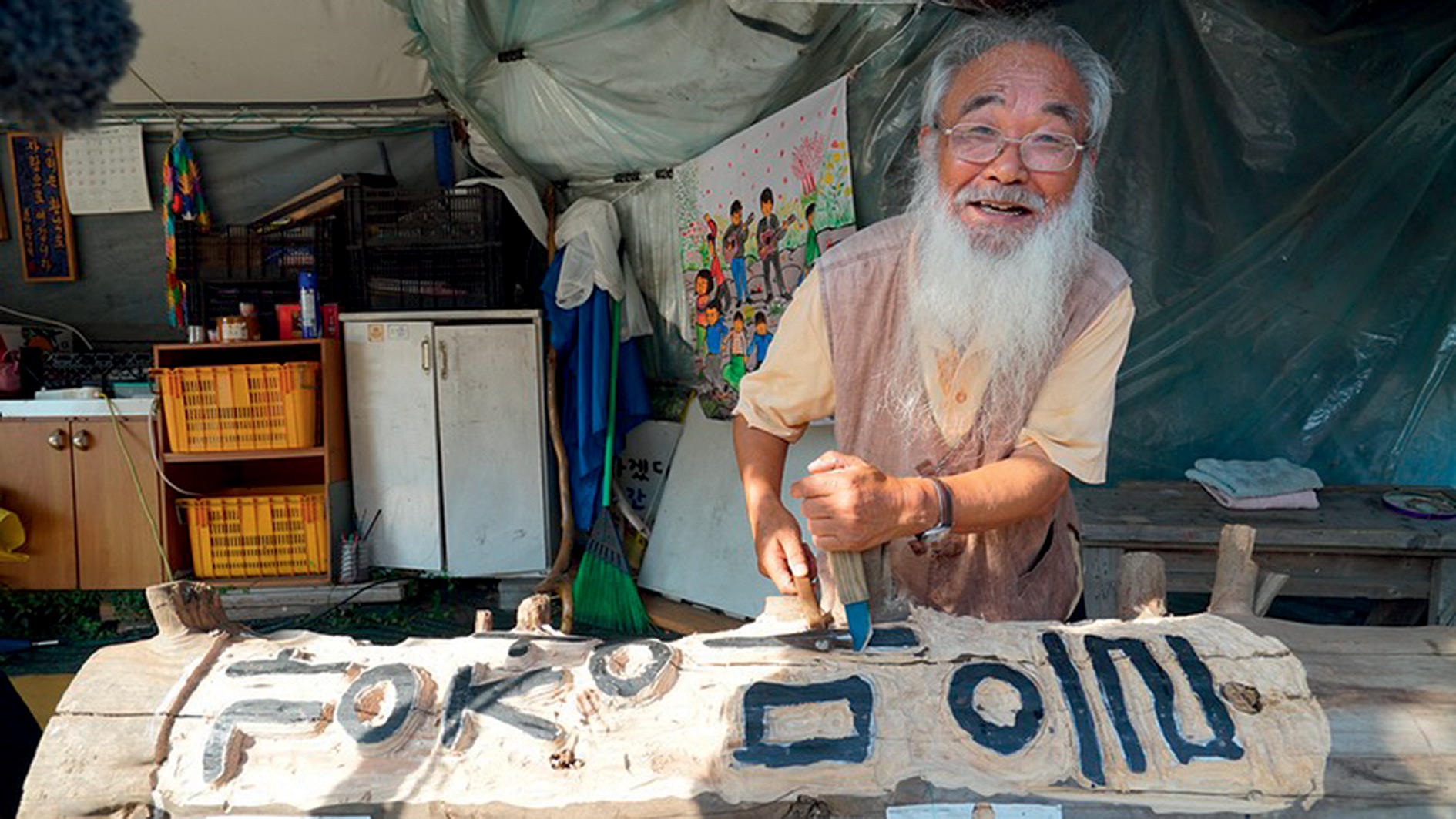 South Korean woodcarver and Catholic priest, Father Mun Jeong-hyeon, leads a daily protest against the building of a naval base that the US will use to target China.
