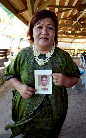 Abacca Anjain-Maddison holds a photo of her uncle, John Anjain, the mayor of Rongelap, which was irradiated  by the 1954 Bravo H-bomb.