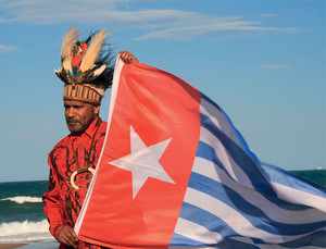 Benny Wenda holds the Morning Star flag – the symbol of a free West Papua.