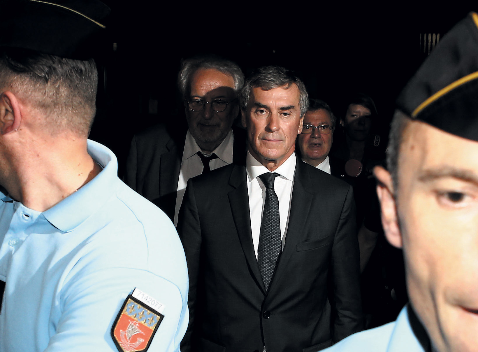 Former French budget minister Jérôme Cahuzac hauled away for tax evasion. His trial opened this September.