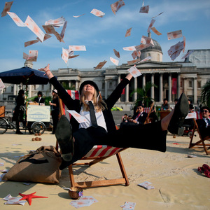 Mimicking the global super-rich at an anti-tax-haven demo in Trafalgar Square during May's Global Anti-Corruption Summit.Photo: Neil Hall/Anadolu Agency/Getty Images