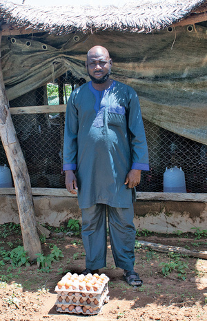 Issaka in front of his hen house with a sample of the eggs it produces. I never understood before this trip that indigenous African hens rarely lay eggs; Issaka's come from France.</p>  <p>