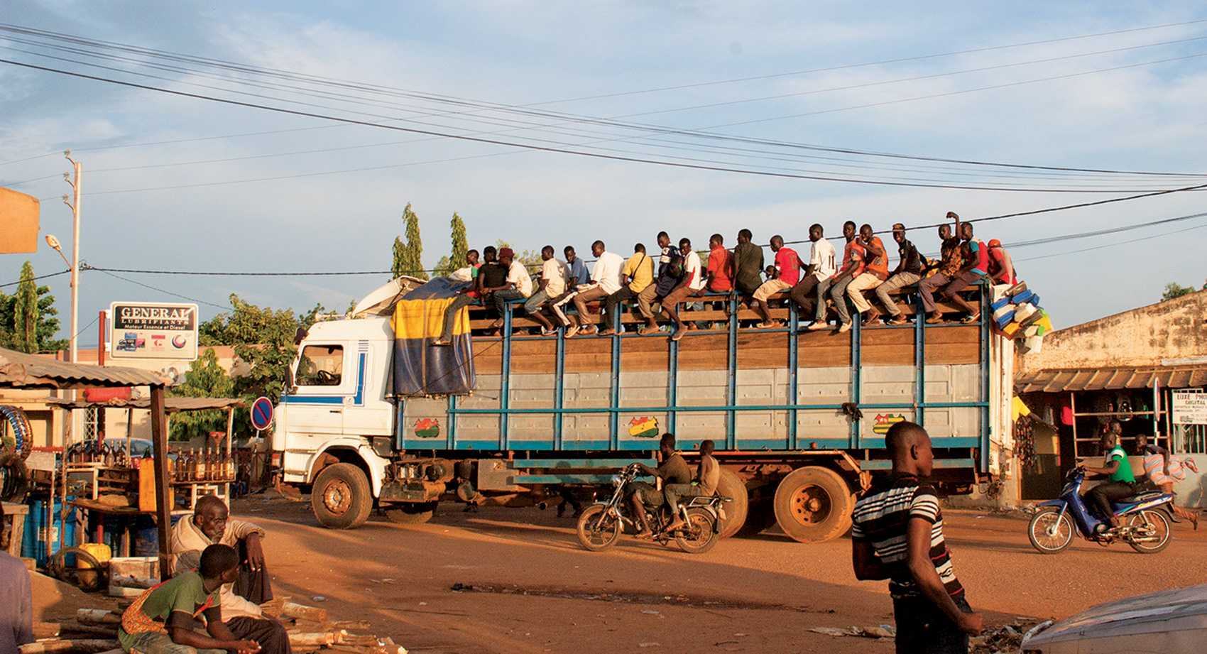 People on the move. A truck with a full cargo of goods and people sets off from the centre of Garango. Young men in particular are determined to seek their fortune in the wider world.</p>  <p>