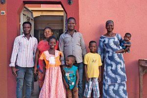 A newly prosperous family: Oumarou (centre) with his wife Bintu and (from left to right) Kadijamila, Abdul Gani Rayan, Muhammad and (in his grandmother's arms) Issa Arif. Oumarou's younger brother Ousmane is on the left.Photo: Chris Brazier