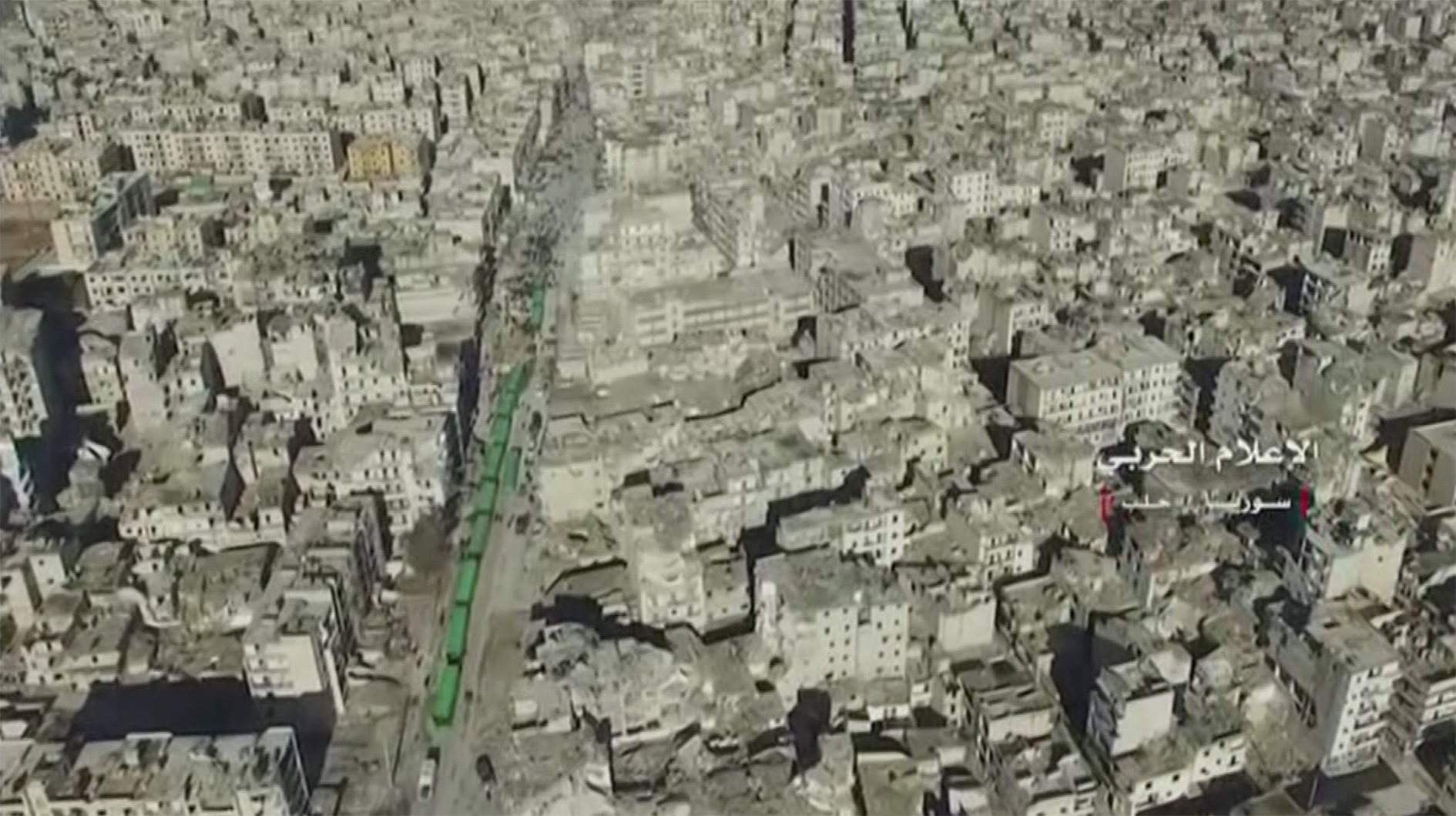 A still image from video taken 15 December 2016 over eastern Aleppo shows an operation to evacuate thousands of civilians and fighters in buses from Aleppo.
