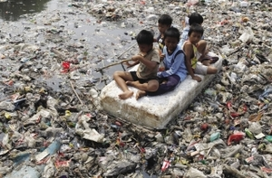 Fun and games in Indonesia – but navigating a path to a healthy future is far from child's play for the poor.Enny Nuraheni / Reuters
