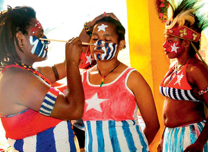 West Papuan women paint their faces with the Morning Star flag before a freedom rally in Jayapura, 19 December 2016.