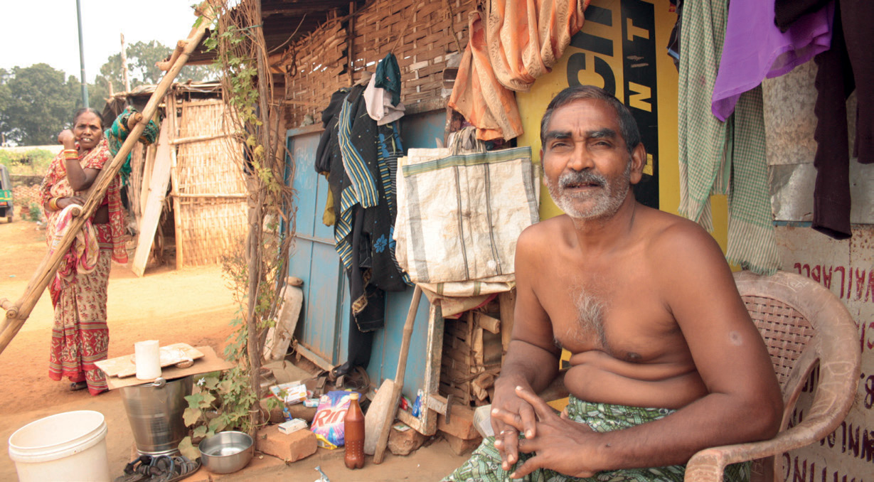 Prashant Kumar das in front of his temporary home. Last year he was forced from a brickand-mortar house, his home for 25 years, so municipal offices could be constructed at the site of the old slum.