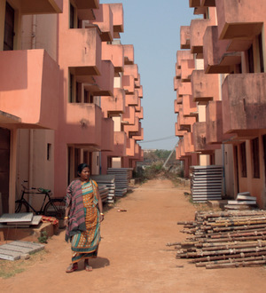 In Bhubaneswar a woman wanders through a deserted apartment complex built under the 15-year-old Basic Services for the Urban Poor scheme. The city and slum residents blame each other for the delay in assigning the 192 empty apartments.