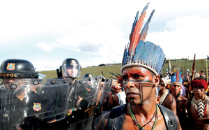 Indigenous people, set to be robbed of their land rights, took their protest to Brasilia – to be rebuffed by armed forces. Photo: Gregg Newton / Reuters
