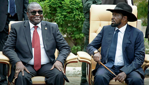Riek Machar (left) and Salva Kiir (right) sit for an official photo. Picture: Albert Gonzalez Farran/AFP/Getty Images