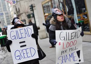Protesters march against the pricing of Sovaldi in 2014, wearing masks of John C Martin – former CEO now Executive Chairman of Gilead.