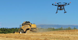 Aerial drone and combine harvester in a version of the new pastoral in a French wheat field.
