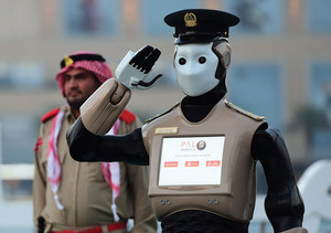 Robocop for real, a police robot makes its debut in Dubai, May 2017. It will help citizens report crimes and answer parking ticket queries, rather than make arrests. 25 per cent of the Dubai police force will be robotic by 2030. Photo: Giuseppe Cacace/AFP/Getty Images