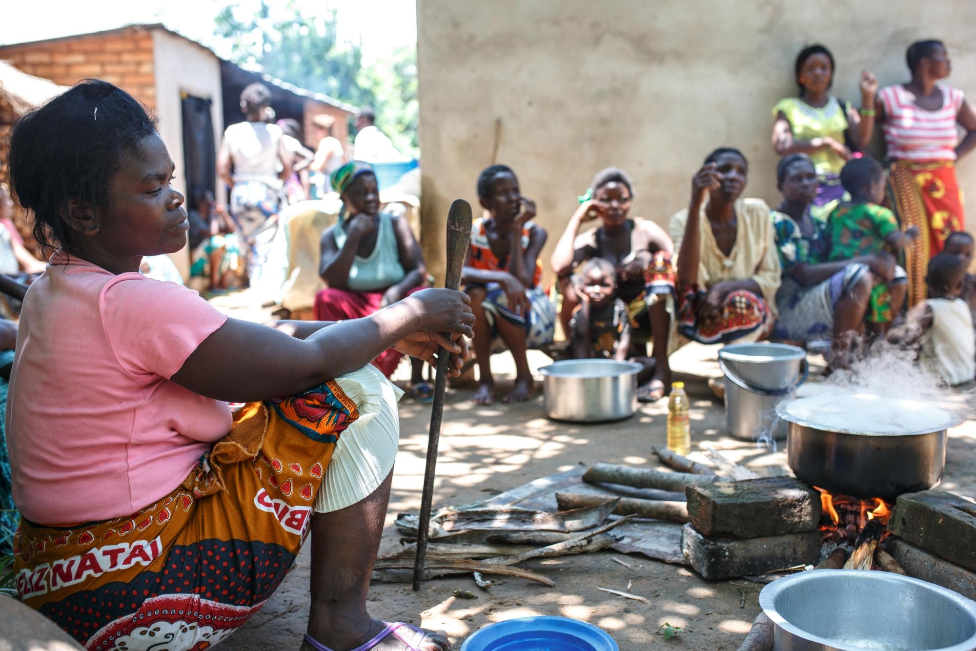 Women in Pitala, a small village near Lake Malawi in the north of the country, cooking over an open 'three-stone' fire.
